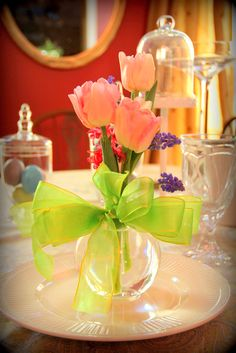 Lovely Spring Center Piece with a simple and elegant vase and ribbon- It's such a shame Tulips can be so difficult to look after...
