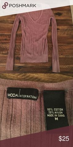 V neck body con sweater Moda International v neck body con sweater. Perfect condition. Worn twice. The color is a muted plum, hard to describe but pretty. Moda International Sweaters V-Necks