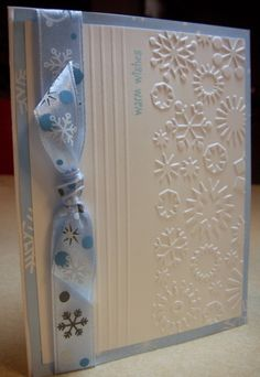 handmade winter card · Cuttlebug snowflake embossing folder ... one of my all-time favs for embossing ... like this card design with simple lines, a knotted ribbon, and just enough space to enjoy the embossed texture ...