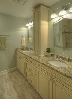 Quoizel Bathroom Mirrors quoizel lighting & mirror; kraftmaid cabinet in biscotti with a
