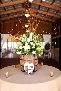 Pretty floral decorations to welcome guests to reception. Floral Design: Alta Fleura --- http://www.weddingchicks.com/2014/05/14/soft-southern-vintage-wedding/