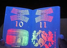 Philippines. Passports under black light — intricate designs exposed under UV (ultraviolet) light.