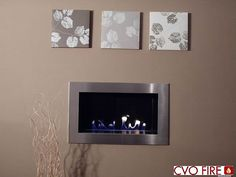 """The ESSENCE """"hole-in-the-wall"""" fireplace has been designed to suit homes where a smaller feature fireplace is required. The Essence uses our award winning ribbon gas burner technology with a beautiful dancing ribbon of flame. The fire is designed with minimal depth, 318mm, and can be installed in most properties with a chimney or by using a flue liner. The 5.7Kw fire is operated by a thermostatic remote control with a digital handset. There are many design options available."""