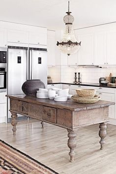 Traditional Kitchen with Oak - Winter White 2 1/4 in. Solid Hardwood Strip, Granite countertop, White subway tile