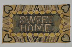 Object Name:Hooked Rug  Maker:Anne Schmidt's mother  Place Made:North America: Canada, Central Canada, Ontario, Waterloo County, Milverton  People:Mennonite  Period:Early 20th century  Date:1900 - 1930  Dimensions:L 50 cm x W 86 cm  Materials:Burlap; cotton; wool