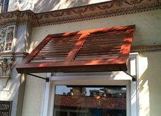 The Tommy Bahamas project features beautiful wood grain finished Aluminum Shutters prominently displayed over the storefront windows. Custom aluminum frame and louver dies were created to achieve a genuine wood appearance for the Aluminum Shutters. B