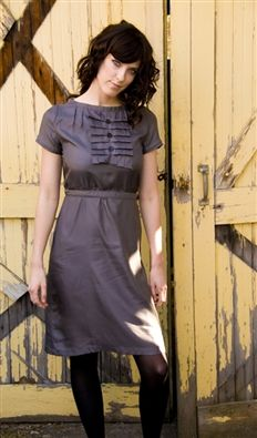 Slate grey tuxedo dress with ruffles on bodice and square buttons.