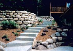 #dolanslandscapecenter #boulderwall #backyard #design #landscape