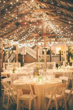 Photographer: Raquel Sergio Photography; Classic white wedding reception with pretty twinkle lights;
