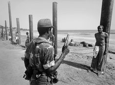Cabinet Ministers lined up to be executed after a coup d'état in Liberia, 1980