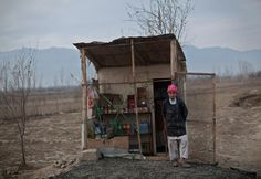 An Afghan boy waits outside his shop for customers in Bagram, north of Kabul on Jan. 3. (Ahmad Masood/Reuters) #