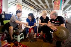 "Small Group Walking Tour: Local Life in Hong Kong's Back Streets Experience another side of Asia's vibrant metropolis on a half-day urban excursion into the local heart of Hong Kong. Try your hand at the strange local tradition of ""villain-hitting"", visit a historic fishing village and square up for a game of mahjong with a local family on the ultimate city tour with a twist.Get a taste of Hong Kong's true local flavour on a backstreets adventure beyond the tourist trail. Star..."