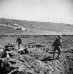 American Marines on the march, Iwo Jima, 1945.