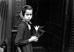 Girl with lily | by HELEN LEVITT, New York, c.1940