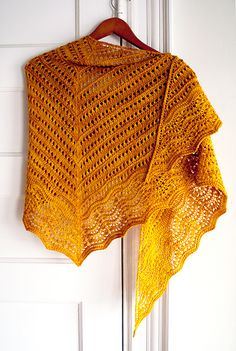 A top-down triangular shawl worked up in 2 skeins of Baah! La Jolla fingering-weight yarn, Florin begins at the center top point with a garter tab and is worked top down, with 6 increases every 2 rows for a wider wingspan than traditional triangular knit shawls.