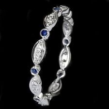 SAPPHIRE DIAMOND RING WHITE GOLD DAINTY WEDDING BAND.  love the pattern of shapes.