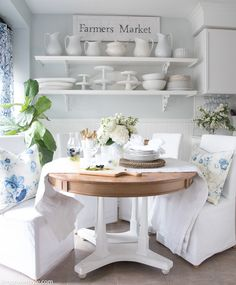 Summer round farmhouse table and open shelving with white dishes