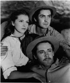The stars of Jesse James (1939): Nancy Kelly, Tyrone Power, and Henry Fonda. Too much beauty for one photo.