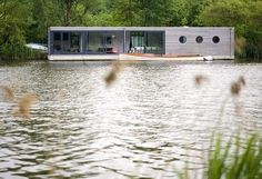 that Modern/ shipping container I love. AND on a lake. sighh
