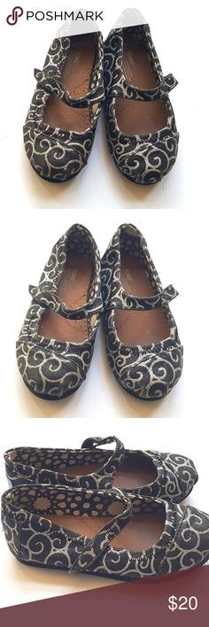Tiny Toms Girls Toddler Mary Jane Shoes Tiny Toms Girls Toddler Mary Jane Black & Silver Swirl Shoes Glitter  Size 9 Toddler Condition: GUC, some toe wear on the very tips   My items come from a smoke-free household, we do have a kitty, so an occasional hair may occur! Toms Shoes