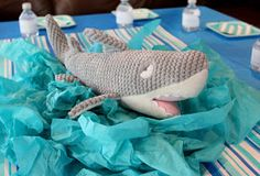 shark stuffed animal in aqua blue tissue paper centerpiece