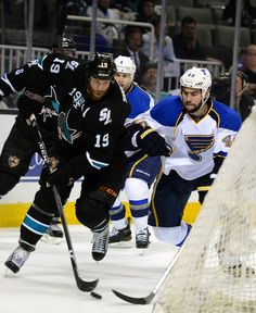 APRIL 16: Joe Thornton #19 of the San Jose Sharks attacks the goal from behind the net guarded by Roman Polak #46 of the St Louis Blues in the third period in Game Three of the Western Conference Quarterfinals during the 2012 NHL Stanley Cup Playoffs at HP Pavilion on April 16, 2012 in San Jose, California. The Blues won the game 4-3. (Photo by Thearon W. Henderson/Getty Images)