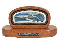 """Humpback Cow and Calf"" Color scrimshaw on ancient mammoth ivory by K. Pettelle. An extremely rare piece from one of the best of the early West Coast scrimshanders. Work is dated: 2-28-81. Pettelle did wildlife and portraits and set a very high standard for anyone to follow. This is from one of our long time collectors who is no longer with us. We had the stand made and it is a gem as well. The blue in the base is crushed turquoise carefully inlaid into an ebony panel.   Size: 6 3/4""L x 2 1/2""D x 3 3/4""H Price: $2,000.00 -- on ScrimshawGallery.com #scrimshaw"