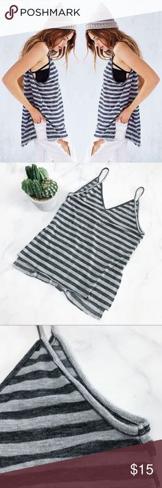 Urban Outfitters Slouchy Striped V-Neck Tank Pre-loved but in good condition! Minor signs of wear. No stains, snags, or tears upon inspection. Urban Outfitters Brand Project Social T (001-0224)   PRODUCT DETAILS: •Size: Small (Oversized) •Colors: Dark and Light Grays •Made in USA •Measurements: Chest-17inch Length-19inch(top of slit)-28.5inch •55% Rayon, 45% Polyester •Machine Wash •V-Neck & Deep V-Back •High Slit •Soft and Cozy •Made to be work over something such as a bandue  •Unstitched…