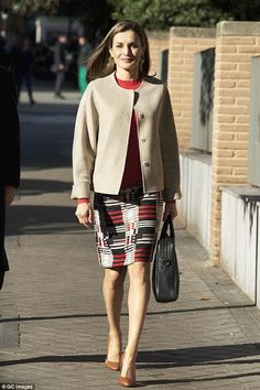 Queen Letizia of Spain attends a meeting of the FEDER (Spanish Federation for Rare Diseases) at FEDER headquarters on January 12, 2017 in Madrid, Spain. Queen Letizia wore HUGO BOSS Hesandra Pixel Tweed Skirt.