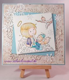 """Winter Greeting Card using """"Angelica"""" from Whimsy Stamps; Designerpaper 6x6 PaperPad """"I Wish"""" Maja Design; Glitter Cardstock Rayher; """"Winterfun Frame"""" Precious Marieke; Snowflake left top corner """"Wintertide"""" Amy Design; small Snowflakes """"Snowflake Flurry"""" WildRoseStudio; """"XXL Nest-lies Squares Double Stitch"""" Crealies; Cardstock CraftEmotions; Colored with TwinklingsH2O"""
