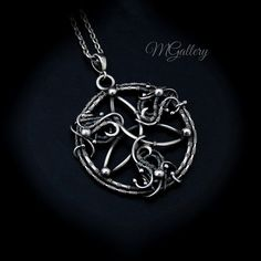 Pendant Triquetra silver wire wrapped by GaleriaM on Etsy