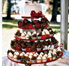 Since neither Meghan nor Matt are huge fans of cake, the couple worked with their caterer to create a cupcake and chocolate-covered strawberry tree. A small cake was placed on top for cutting.