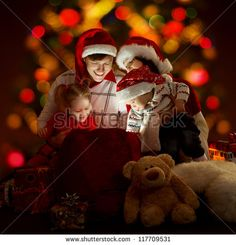 Christmas family of four persons in red hats opening lighting bag with gifts - stock photo