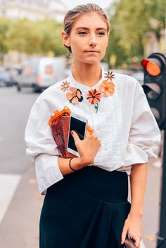 October 7, 2015  Tags Orange, Black, Red, White, Paris, Balenciaga, Women, Florals, Clutches, Skirts, Blouses, Snakeskin, Jenny Walton, SS16 Women's, 1 Person, Flowers