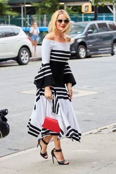 Mesmerized by her recent sartorial excellence, Margot Robbie delighted us once again, stepping out in a graphic black and white knit dress today in NYC. The eye-catching number proves two things: The timeless power of contrasting black and white and that asymmetrical hems are here to stay.