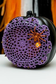 Learn how to turn a faux Halloween pumpkin into a fun light-up Jack-o-lantern complete with doily spiderweb with this easy DIY project.