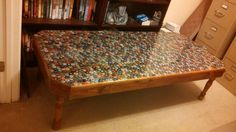 beer bottle cap covered coffee table covered with resin so its like a sheet of glass. removable legs short for coffee table tall ones for a party table. Happy Birthday / Christmas Weasel