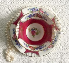 An absolutely beautiful china tea cup and saucer, made by Royal Stafford in England. This duo has a white and raspberry ground with lots of gilding and a floral centre. It is in perfect condition, no chips, cracks or crazing. Please Note: The items I sell are not new, they are
