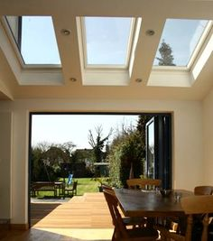 Quality centre pivot skylight windows by VELUX, FAKRO & more. Folding Patio Doors, Bifold Doors Onto Patio, Kitchen Bifold Doors, Bi Folding Doors Kitchen, Glass Extension, Extension Ideas, Bifold Doors Extension, Extension Google, Kitchen Diner Extension
