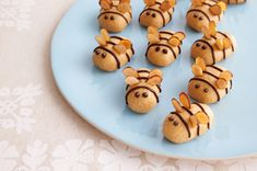 Peanut Butter Bumble Bees recipe - Here is a fun idea to kick-off Spring! To prevent the peanut butter mixture from sticking to your hands, dust your hands with additional icing sugar before using to roll the peanut butter mixture into ovals.