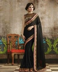 Black lycra sari paired with a heavy embroidered dupion silk blouse. This sari is beautified with floral embroidered border and the blouse has embroidery work and stone work. It comes with a matching unstitched blouse.