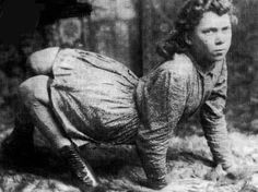tamburina:    This unusual young woman is identified as Lucy Elvira Jones, and was born in 1881 and shown in the Texas State Fair in 1894. During her shows she ran around like a dog and thus was dubbed 'The Dog Girl'.