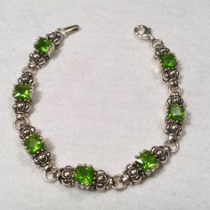 """Sterling Silver Peridot 7 1/2"""" bracelet New without tags..beautiful..just stunning..measures 7 1/2"""" length 1/4"""" width..purchased at Macy's but never worn..there is a matching that is also for sell Macy's Jewelry Bracelets"""