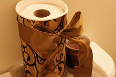 from oatmeal canister to upscale TP holder... a great idea for those who are entertaining this holiday season!