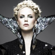 Charlize Theron as the Wicked Queen... She is badass!!!