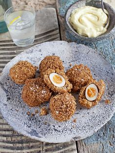 These crab scotch quail's eggs with mustard mayo make a great twist on a classic British snack. They're easy to make but look impressive making them perfect to serve with drinks.