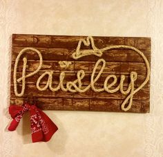 The meaning of the name Paisley is.... Church The origin of the name Paisley is Scottish Alternate spellings: Paislie Read more at http://www.babynames.com/name/Paisley#c5UX7VmMXU8G6jp0.99Western Wood Rope Name Sign Baby Country Rustic by MemoryScapes