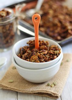 pumpkin granola with pepitas, chia seeds, pumpkin pie spice, dates, cloves, maple syrup and pumpkin puree