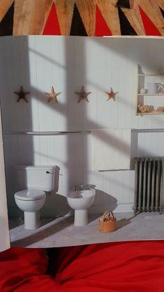 Full length towel rail in kitchen or bathroom