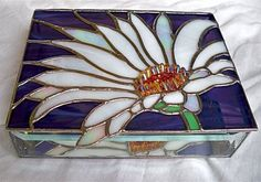 Stained Glass Jewelry Box WHITE DAISY by glassmagic on Etsy This jewelry box measures x x high. It features beveled sides and a mirrored bottom, for optimum reflections. A dainty chain holds the hinged box lid securely when opened. Dragonfly Stained Glass, Making Stained Glass, Stained Glass Flowers, Faux Stained Glass, Stained Glass Lamps, Stained Glass Projects, Stained Glass Patterns, Stained Glass Windows, Mosaic Glass